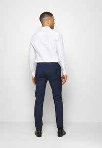 Tommy Hilfiger Tailored - SEPARATE PANT - Suit trousers - blue - 2