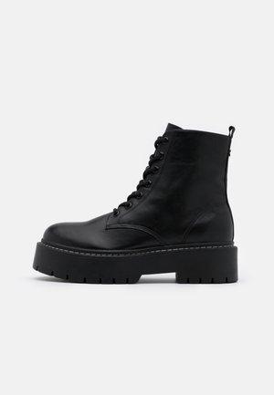 YELABUGA - Platform ankle boots - black