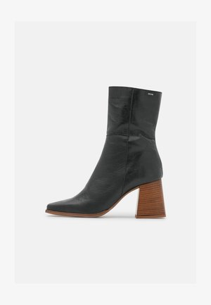PORTYA - Classic ankle boots - black