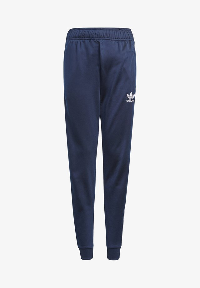 ADICOLOR SST TRACK PANTS - Verryttelyhousut - collegiate navy/white