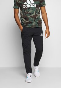 adidas Performance - Pantalon de survêtement - black/white - 0