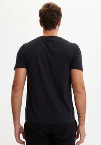 DeFacto - Print T-shirt - black - 2