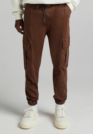 Reisitaskuhousut - brown