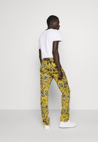 Versace Jeans Couture - MILANO ALLOVER PRINT - Slim fit jeans - black - 2