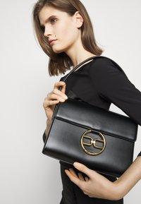 Elisabetta Franchi - RING LOGO SHOULDER BAG - Handbag - nero - 1