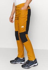 The North Face - MEN'S CLIMB PANT - Trousers - timbertan/black - 3