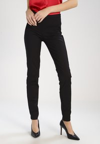YAS Tall - YASPEYTON ECCO - Trousers - black - 0