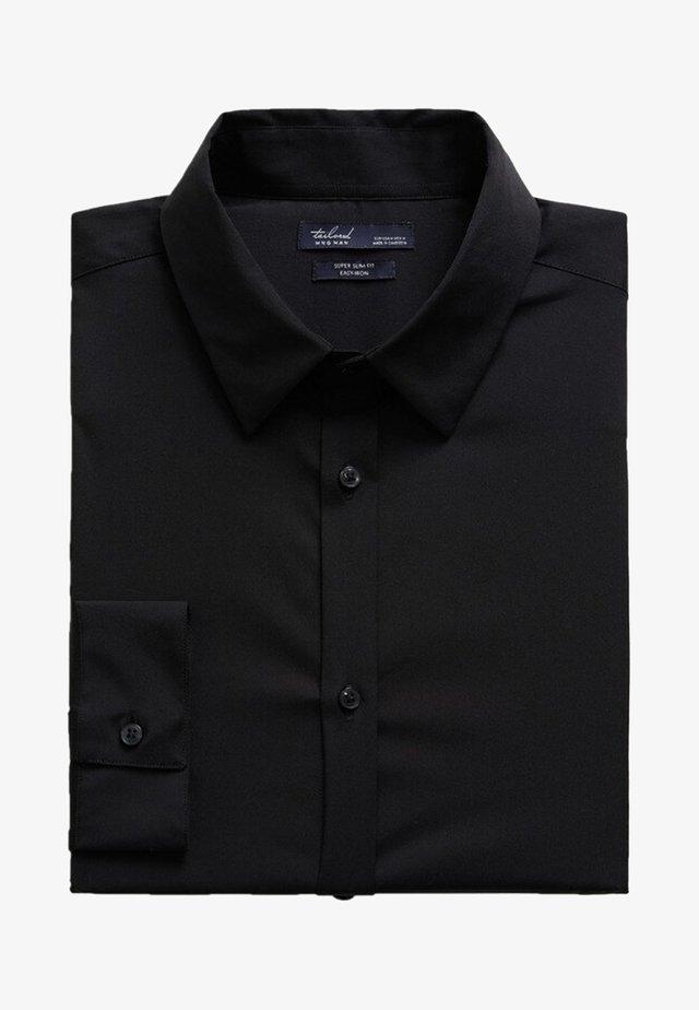 EMOTION - Shirt - schwarz