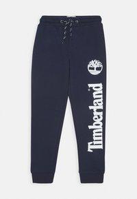 Timberland - Teplákové kalhoty - navy - 0