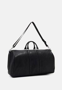 Guess - SCALA UNISEX - Weekend bag - black - 1