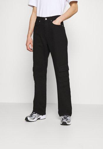 MARCUS BUTLER FOR CARPENTER - Cargo trousers - black