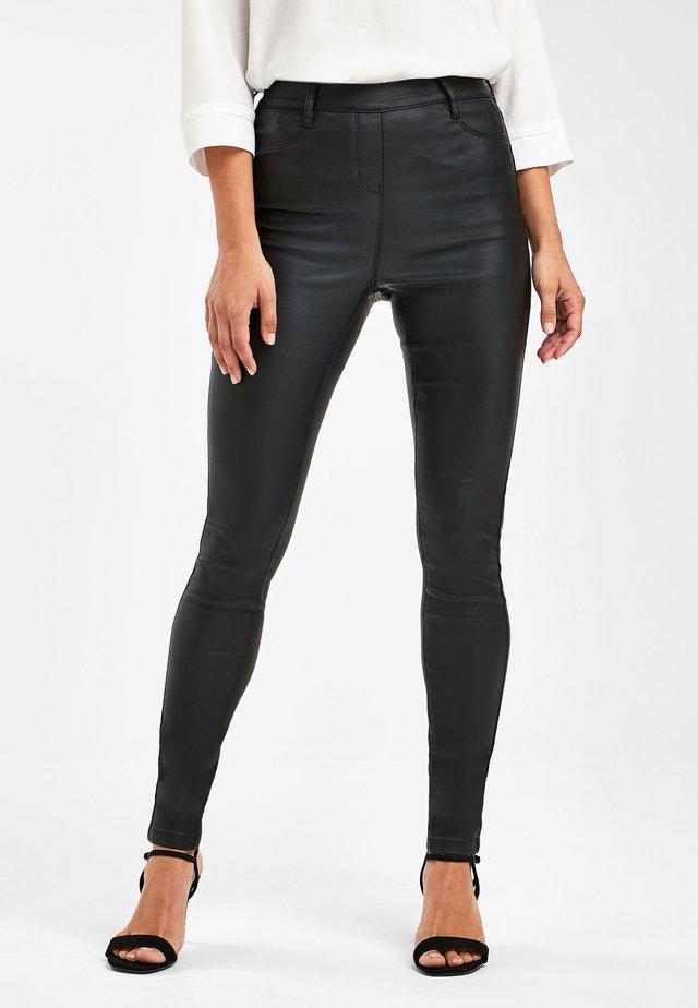 PULL ON COATED - Leggings - Trousers - black
