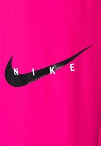 Nike Performance - RUN PANT - Pantalon de survêtement - fireberry/arctic punch/black - 5