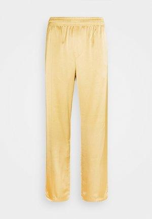 KEN STAIN TRACK PANTS UNISEX - Kangashousut - beige
