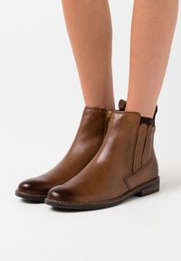 Marco Tozzi by Guido Maria Kretschmer - Ankle boots - cognac - 0