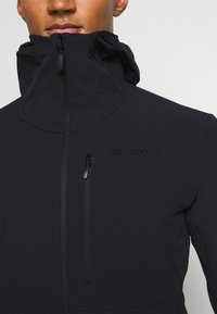 Norrøna - LOFOTEN HOOD - Ski jacket - black - 3