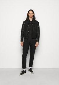 KARL LAGERFELD - PRESS BUTTON - Polo shirt - black - 1
