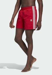 adidas Originals - ADICOLOR CLASSICS 3-STRIPES SWIM SHORTS - Swimming shorts - red - 0