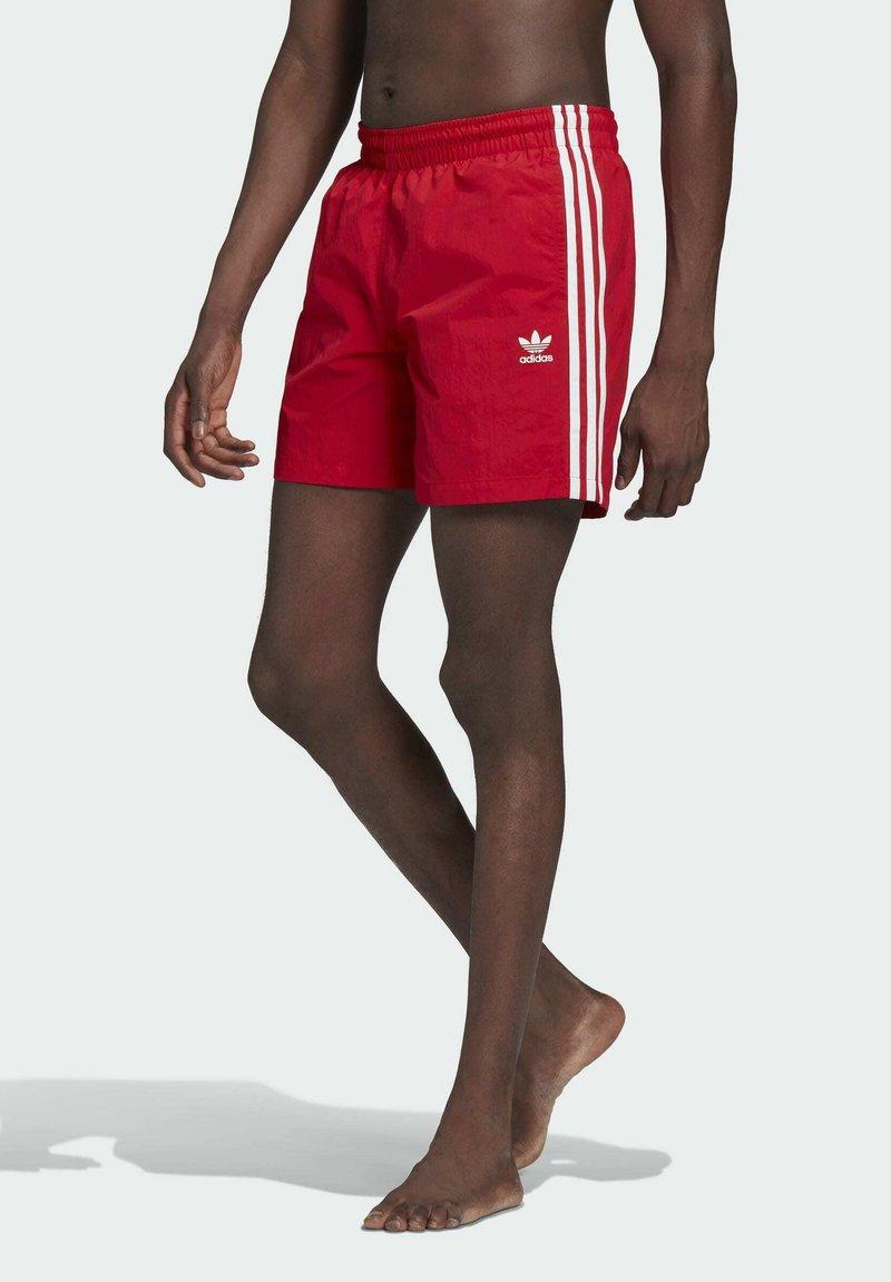 adidas Originals - ADICOLOR CLASSICS 3-STRIPES SWIM SHORTS - Swimming shorts - red