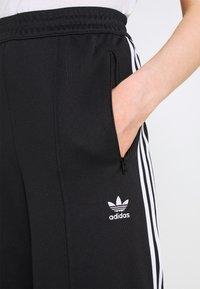 adidas Originals - TRACK PANTS - Pantalones deportivos - black - 4
