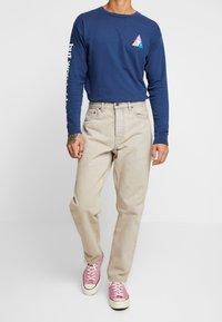 Carhartt WIP - NEWEL PANT MAITLAND - Relaxed fit jeans - blue sandbleached - 0
