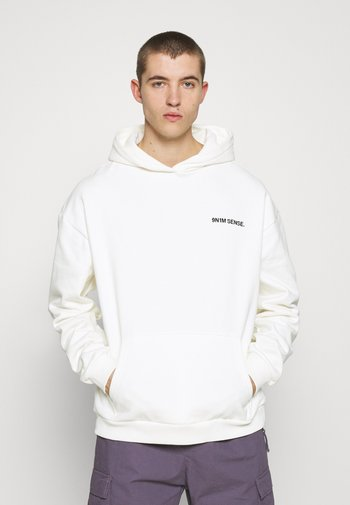 LOGO HOODIE UNISEX - Sweatshirt - cream