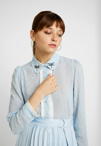 Sister Jane - WANDERING WINGS EMBELLISHED BLOUSE - Button-down blouse - light blue - 0