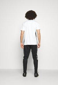 adidas Performance - TIRO  - Spodnie treningowe - black - 2