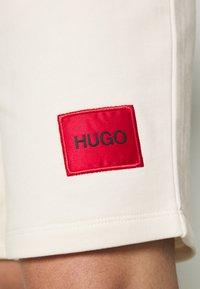 HUGO - Tracksuit bottoms - natural - 5