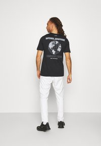 Under Armour - PROJECT ROCK FIRE  - T-shirts print - black - 2