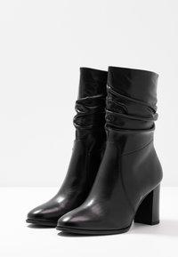 Tamaris - Classic ankle boots - black - 4
