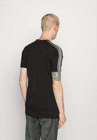 Ellesse - CARCANO - Print T-shirt - black - 2