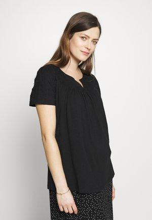 NURS DALLES - T-shirts med print - black