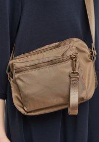 s.Oliver - Across body bag - beige - 2
