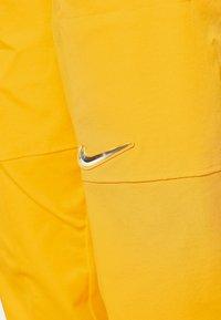 Nike Sportswear - PANT  - Pantalon de survêtement - university gold - 3