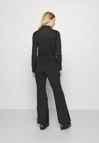 Superdry - SLALOM SLIM - Zimní kalhoty - black - 2