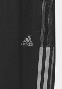 adidas Performance - TIRO UNIESX - Tracksuit bottoms - black - 2