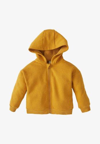 Vetoketjullinen college - yellow