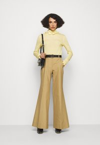 Victoria Beckham - WIDE BOOTCUT TROUSER - Trousers - taupe - 1