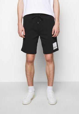 TECH - Pantaloni sportivi - black