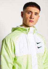 Nike Sportswear - Summer jacket - barely volt/white/blue force - 4