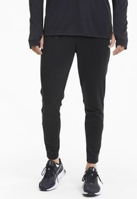 Puma - Tracksuit bottoms -  black - 0
