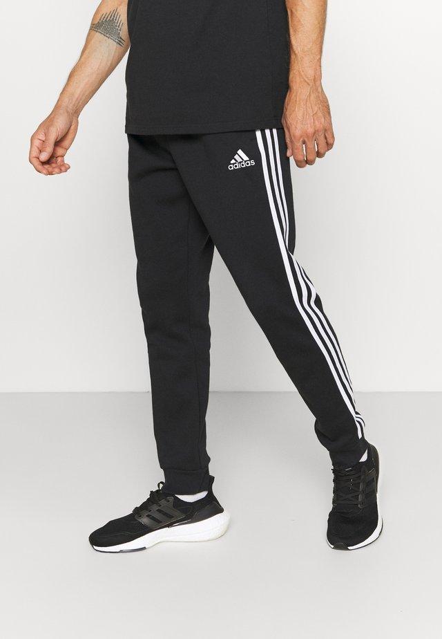 Tracksuit bottoms - black/white