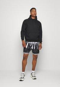 Jordan - WINGS  POOLSIDE - Shorts - white/black/dark smoke grey - 1