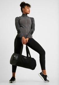 adidas by Stella McCartney - ROUND DUFFEL S - Sports bag - black/black/white - 1