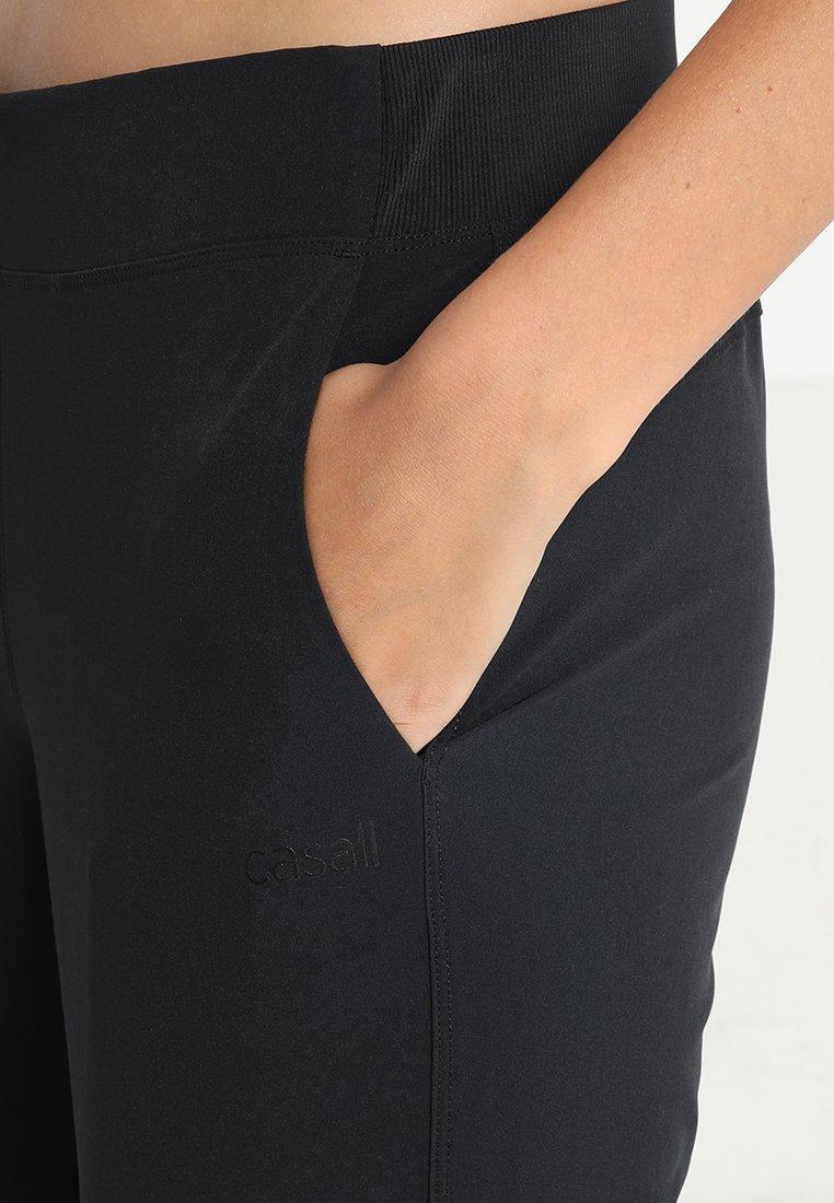 Popular y barato Casall CASALL SLIM WOVEN PANT  Pantalones  black qzmsY