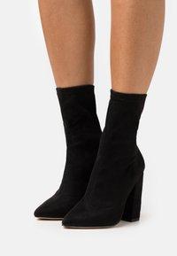 Missguided - FLARED HEEL SOCK BOOT - Bottines - black - 0