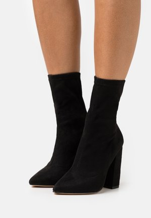 FLARED HEEL SOCK BOOT - Classic ankle boots - black
