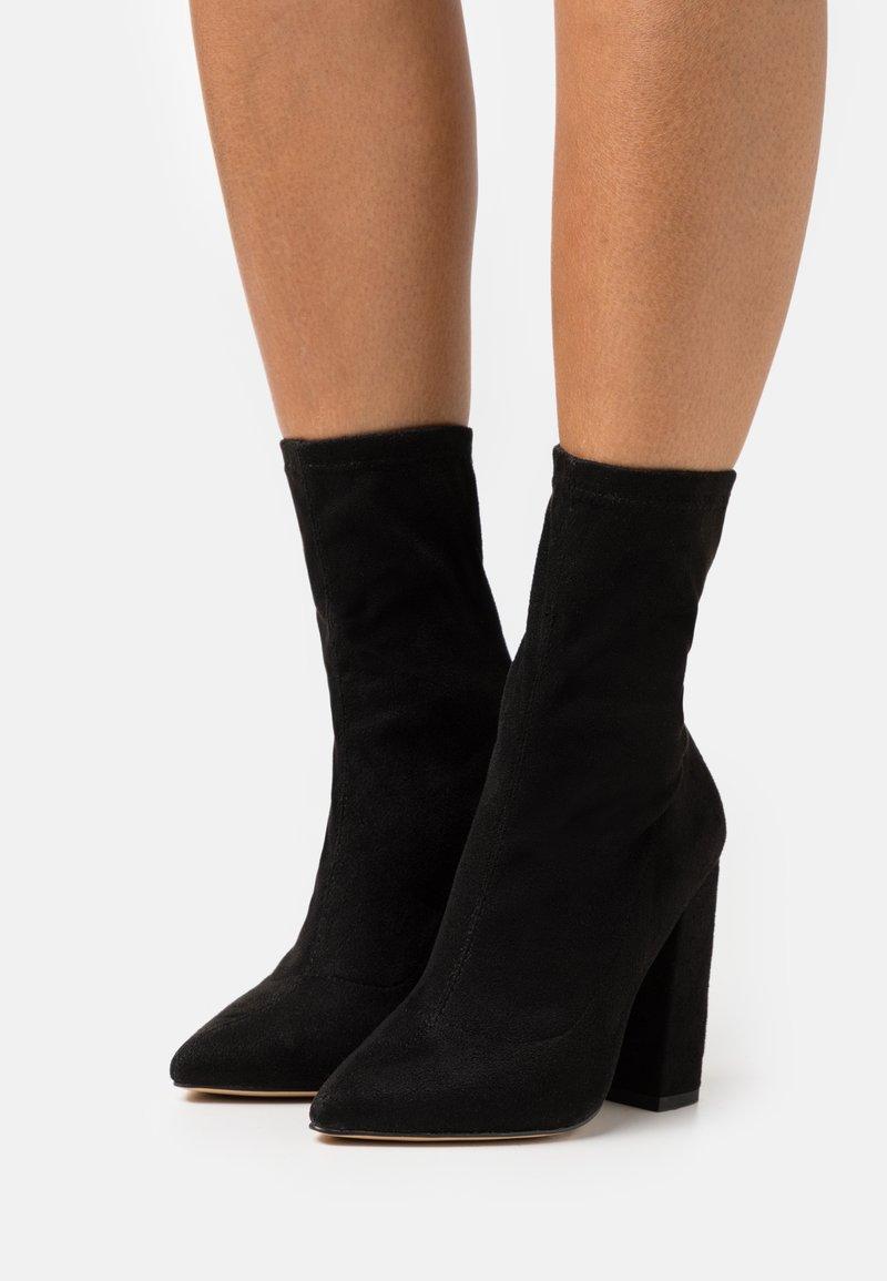 Missguided - FLARED HEEL SOCK BOOT - Bottines - black