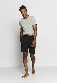 Calvin Klein Underwear - ONE SLEEP - Pyžamový spodní díl - black - 1